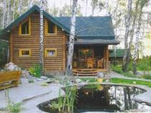Двухэтажный деревянный дом-баня