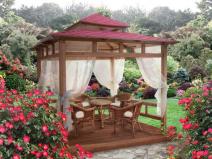 Плетеная мебель в открытой садовой беседке
