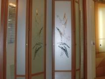 Стеклянная дверь-книжка с несколькими створками