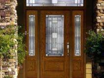 входные двери из массива со стеклом
