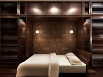 Уютный вариант спальни с применением мягкого освещения