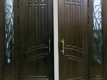 железные тамбурные двери с элементами ковки